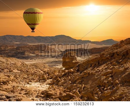 Sunset over Egypt Sinai desert landscape and balioon. Travel concept