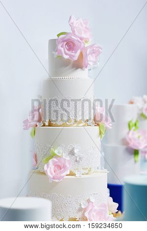 Wedding Cake Decorated With Pink Peonies