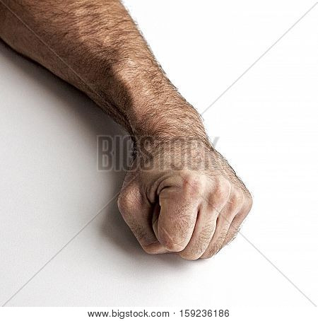Men's gestures. Fist of the man on a white background