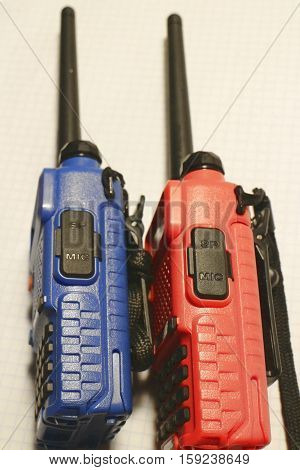 Two walkie talkies portable radio stations close-up