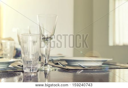 abstract scene of glass on dinner table set with vintage lens fare filter - can use to display or montage on product