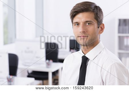 Man In White Shirt And Tie In Office