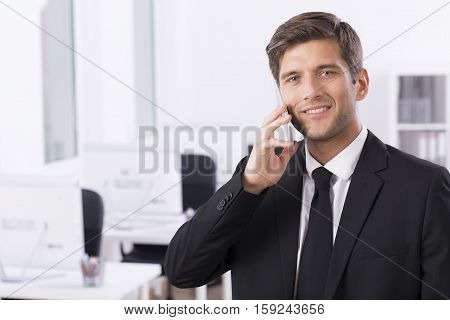 Elegant Businessman Talking On The Phone