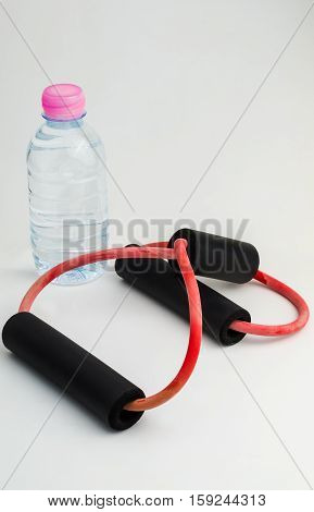 Isolated water bottle and resistance on white background