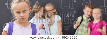 Sad School Girl And Children Laughing And Backbiting Her