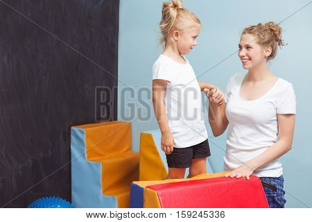 Child Holding A Tutor