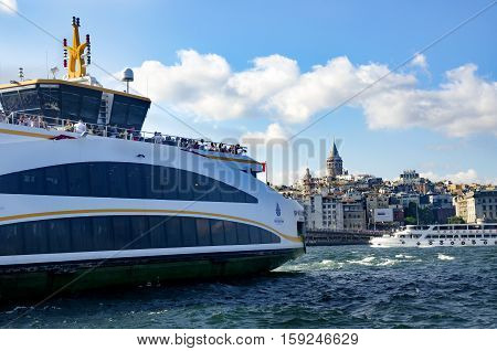 Istanbul Turkey - July 26 2016: Istanbul Eminönü pier and new types of boats. The symbol of Istanbul Galata bridge and Galata tower appears Istanbul views