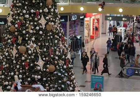 BRNO,CZECH REPUBLIC-NOVEMBER 19,2016:Christmas tree with decorations and walking people at shopping center Olympia on November 19, 2016 Brno Czech Republic