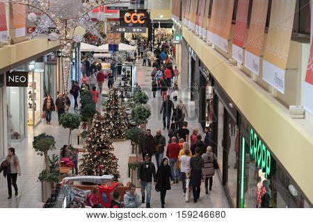 BRNOC,ZECH REPUBLIC-NOVEMBER 19,2016:Christmas decoration and walking people at shopping center Olympia on November 19, 2016 Brno Czech Republic