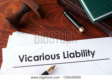Papers with title Vicarious Liability on a table.