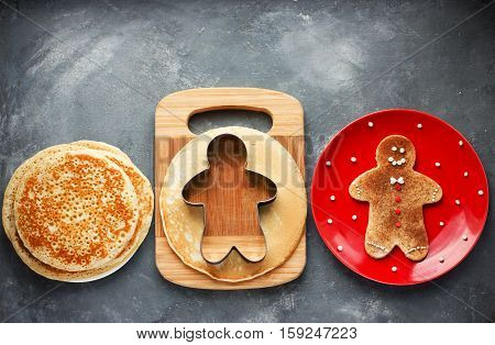 Christmas gingerbread man pancake with cinnamon sugar. Christmas breakfast brunch or dessert idea for kids