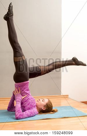 Sporty Girl On White Background Doing Shoulder Stand Exercise, Asana Viparita Karani, Upside-down Se