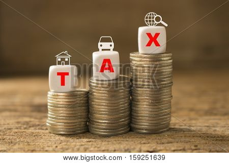 coins of stack with dice and text of tax concept idea for business and time for tax.