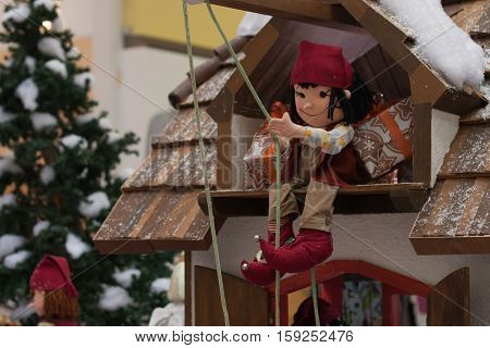 BRNO,CZECH REPUBLIC-NOVEMBER 19,2016:Christmas elf pulling using pulleys gifts at shopping center Olympia on November 19, 2016 Brno Czech Republic