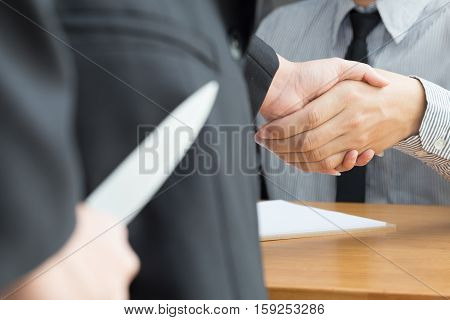 Blackmail concept Business handshake and doing agreement
