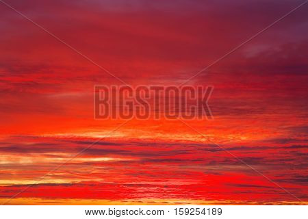 Fiery orange and red sunset sky. Apocalyptic sky