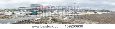 Zrenjanin Vojvodina Serbia - September 25 2015: Landscape transform into urban area with machinery people are working. Panoramic view of construction site.