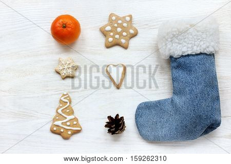 flat layout different holiday items on a light wood table / riddle about the new year