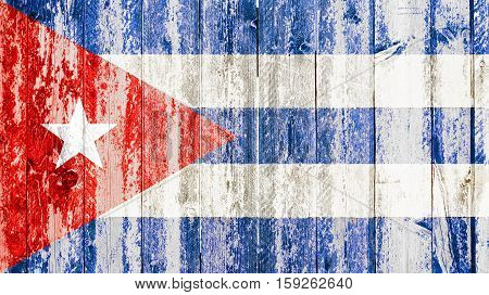 old grunge cuban flag on broken crack wood with rift havana cuba communist dictatorship pray for president concept poster
