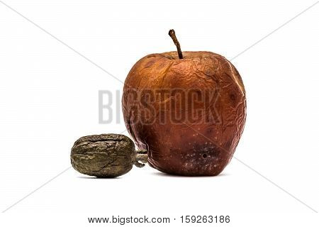 Rotten fruits, apple and feijoa on white background