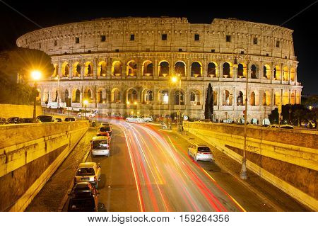 View of Famous Rome Colosseum at night. Italy