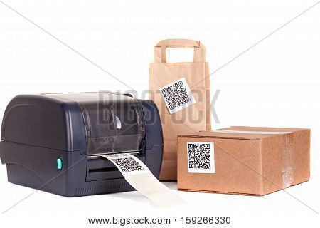 Barcode printer and packaging boxes marked with a bar code.Dummy barcode contains text