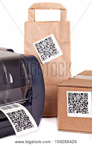 Barcode printer and packaging boxes marked with a bar code .Barcode for use - no copyright issues as constructed.