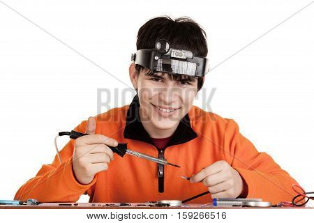 Boy learning to solder wire. Studio shot. Isolated on white background.