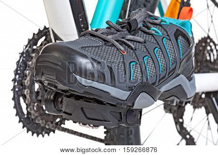 Closeup of special contact shoe attached to the bicycle pedal.