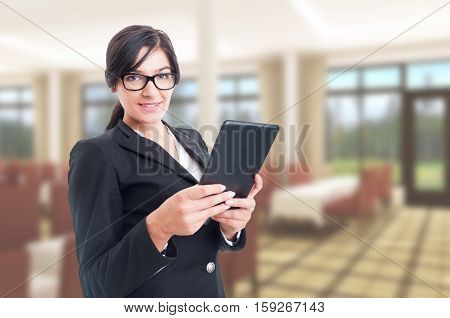 Confident Sales Agent Browsing On Digital Tablet