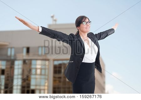 Joyful Female Realtor With Arms Outstretched
