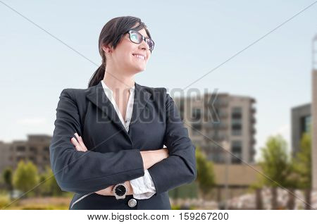 Beautiful Estate Broker Posing With Folded Arms