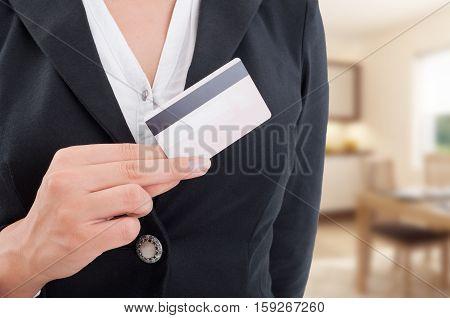 Female Broker With Debit Card In Closeup