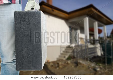 Male Constructor With Toolbox In Close-up