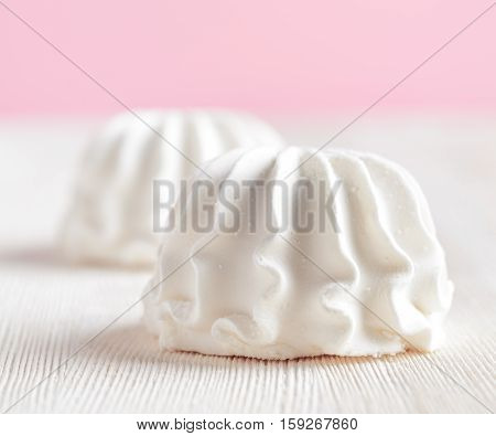 White Marshmallow On Wooden Table