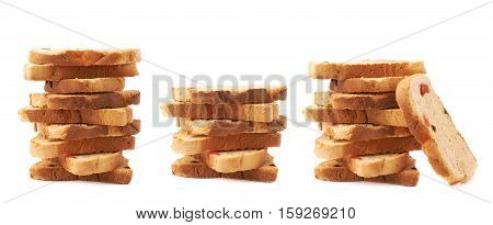 Stack of rusks with the pieces of dried fruits isolated over the white background