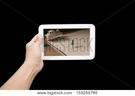 hand holding tablet with calendar of christmas on december 2016 image on black backgroundconcept for count down or new yeaer