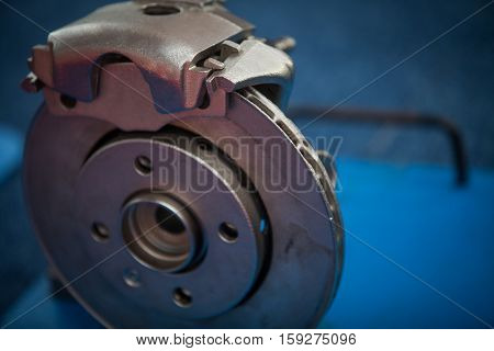 Close up image of a car's brake disk and caliper.