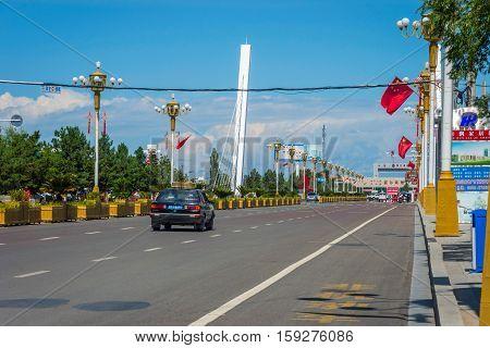 KHORGOS, CHINA - JULY 7: Taxi passing towards border checkpoint between Kazakhstan and China. July 2016