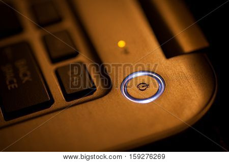 Close up shot of a laptop power button.