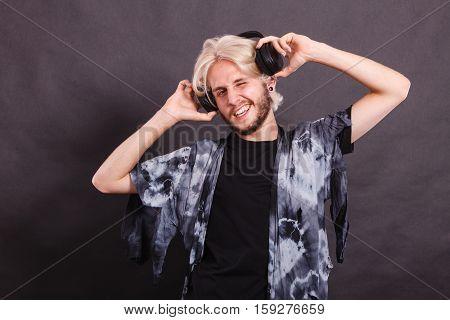 Blonde Man Singing In Studio Wearing Headphones
