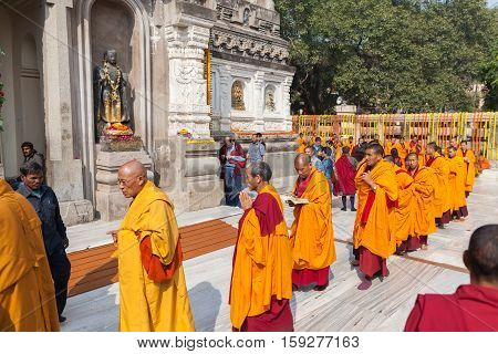 January 29 2014. India. Bodh Gaya. Group of monks - pilgrims do kora (a traditional round of the temple a stupa or other holy site) around Mahabodhi Temple during an annual menlam.