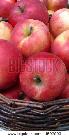 photo of red applesidared in the basket poster