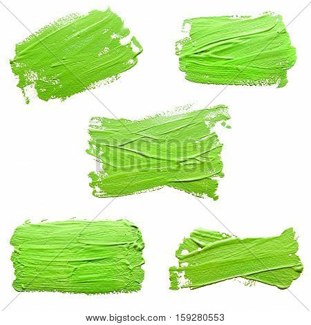Collection of photos green strokes of the paint brush isolated on a white