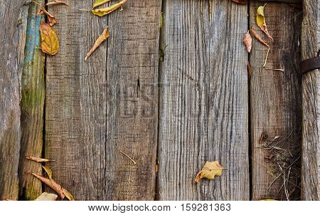 Old wooden fence darkened from the weather .