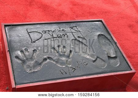LOS ANGELES - DEC 1:  Donnie Yen Hand And Footprints at the Donnie Yen Hand And Footprint Ceremony at TCL Chinese Theater IMAX on December 1, 2016 in Los Angeles, CA