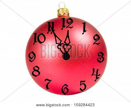 Bright red Christmas ball with a clock face showing almost twelve o'clock (isolated on white)