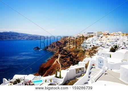 Oia, traditional greek village and Aegan sea waters, Santorini, Greece, retro toned