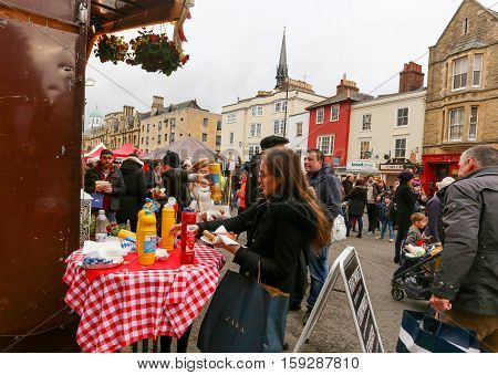 Broad Street Oxford UK 27th November 2016: The Real German Sausage stall with ketchup and senf table on Oxford's Christmas Light Festival
