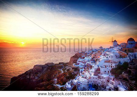 famouse sunset of Oia over Aegan seal, night over Santorini island, Greece, retro toned